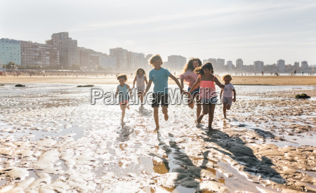 group of six children running together