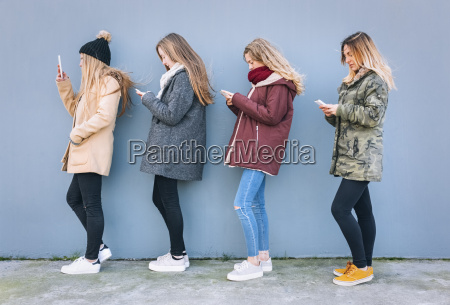 four young women standing in a