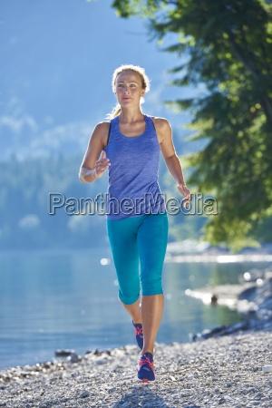 germany bavaria young woman jogging at