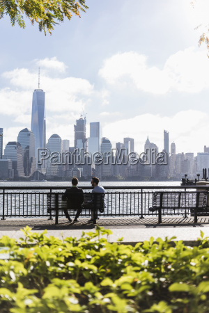 usa two businessmen sitting on bench