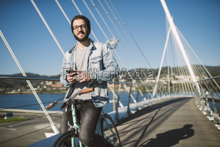 smiling young man with fixie bike