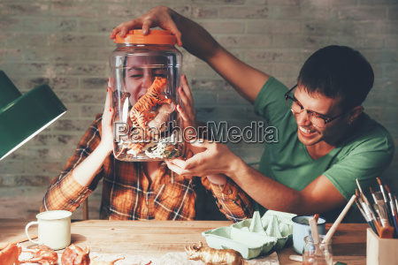 young couple having fun with animal