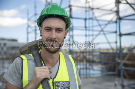 construction worker on construction site holding