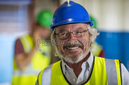 senior engineer wearing safety helmet portrait