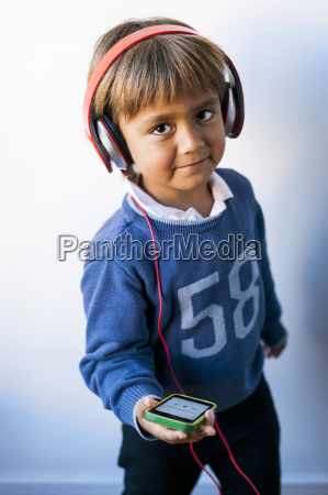 little boy listening to music of