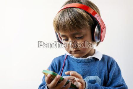 little boy listening to the music