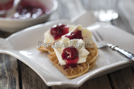 plate of waffles with whipped cream