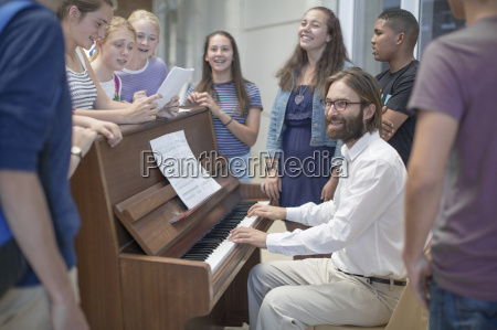 teacher with group of students standing