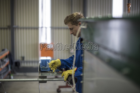 factory worker in truck manufacture assembling