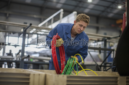factory worker in truck manufacture sorting