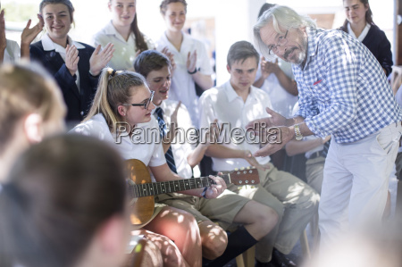 teacher and students having music lessons