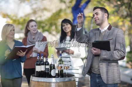 sales people preparing wine selling event