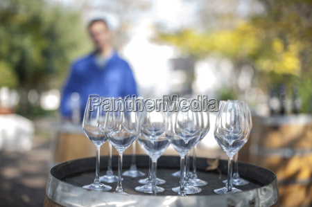 empty wine glasses on barrel with