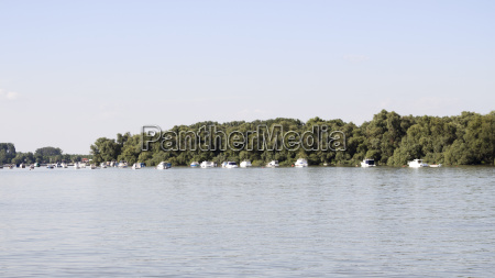 boats anchored on danube river with