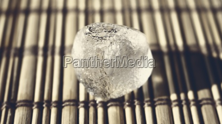 ice cube on the wooden surface