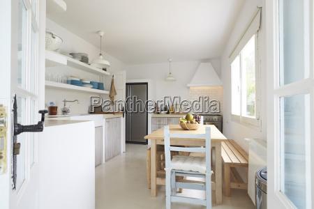 modern kitchen viewed through open french