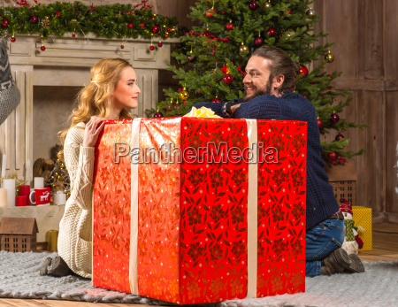happy couple with gift box