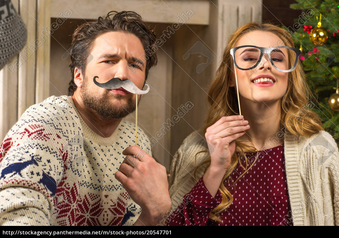 couple, having, fun, with, party, sticks - 20547701
