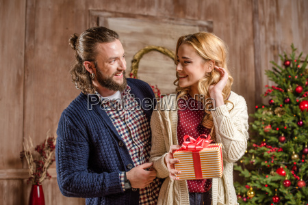happy, couple, with, christmas, present - 20547337