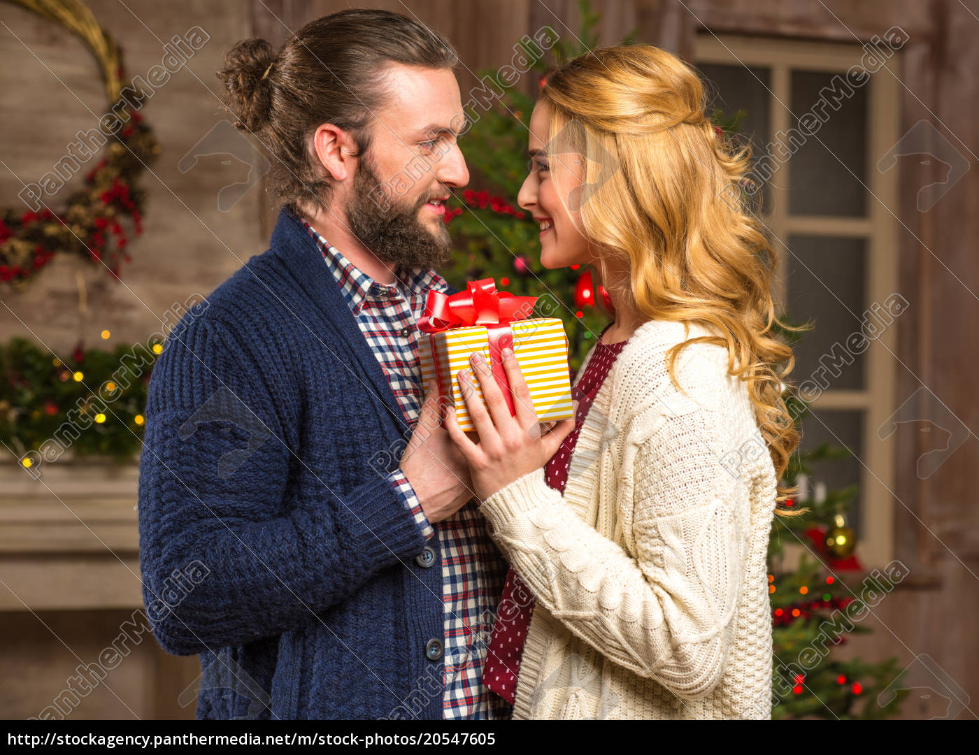 happy, couple, with, christmas, present - 20547605