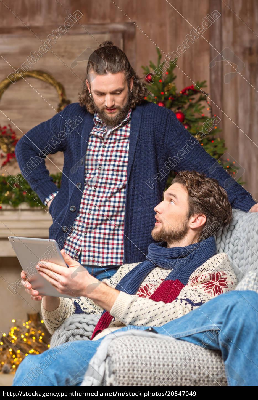 men, using, tablet, in, cozy, room - 20547049