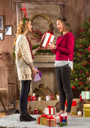 women sharing christmas presents