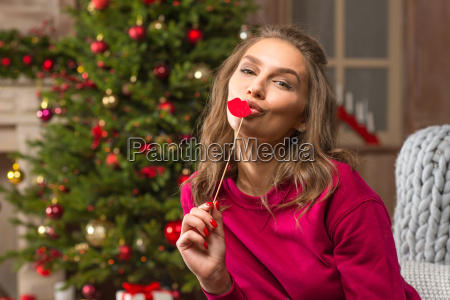 smiling woman holding paper lips