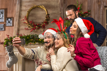 happy people taking selfie at christmastime