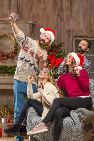 happy people taking selfie at christmastime