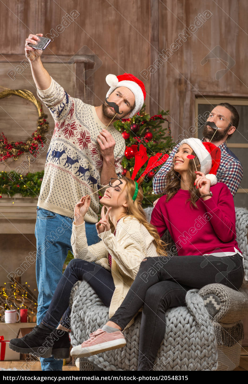 happy, people, taking, selfie, at, christmastime - 20548315
