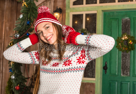 smiling, woman, in, hat, and, mittens - 20548527