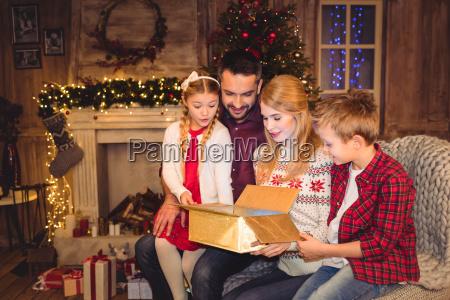 family opening gift box