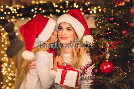 happy mother and daughter in santa
