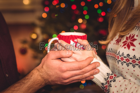 couple, holding, cup, with, hot, drink - 20549711