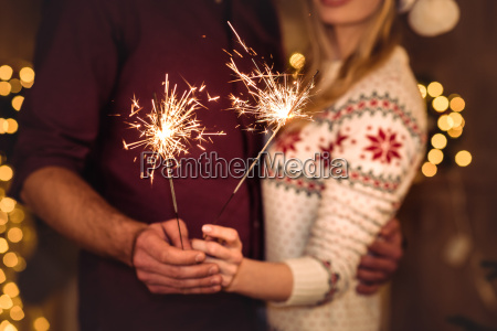 couple, holding, sparklers - 20549953