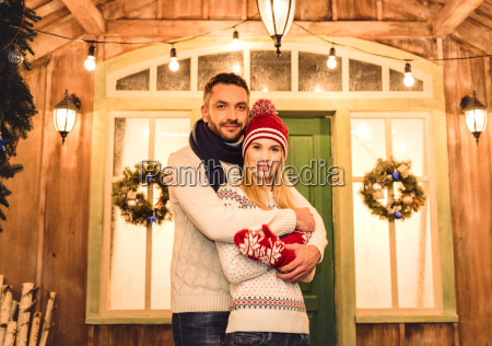 couple, in, knitted, sweaters, hugging - 20549959