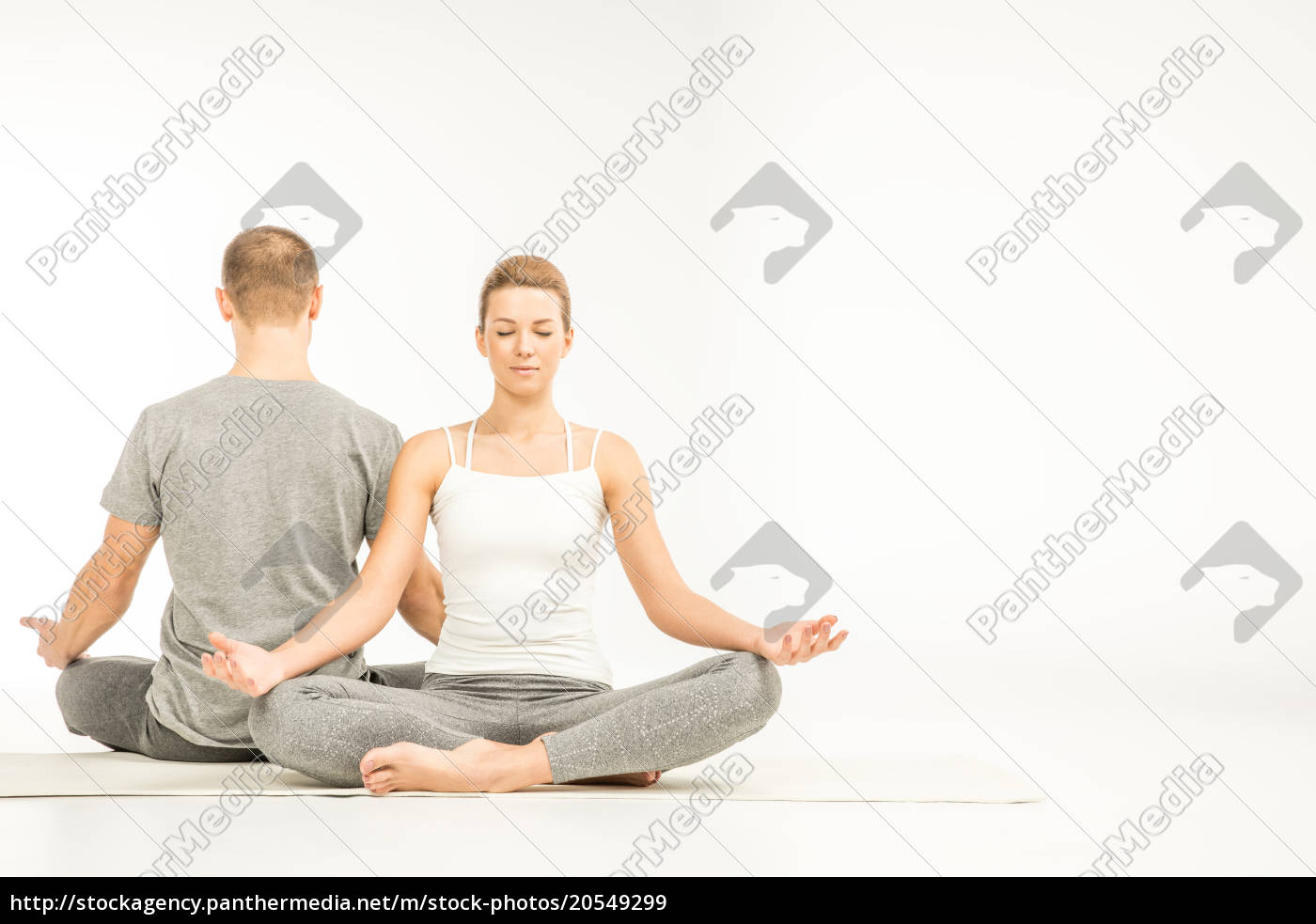 couple, sitting, in, lotus, position - 20549299