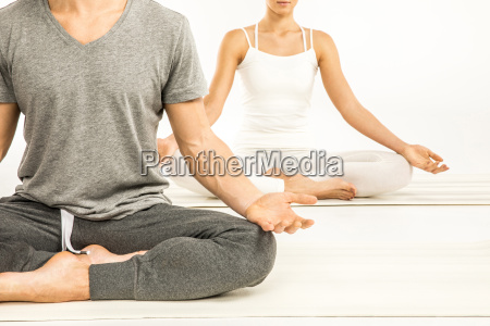 couple, sitting, in, lotus, position - 20549317