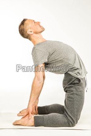 man, standing, in, yoga, pose - 20549313