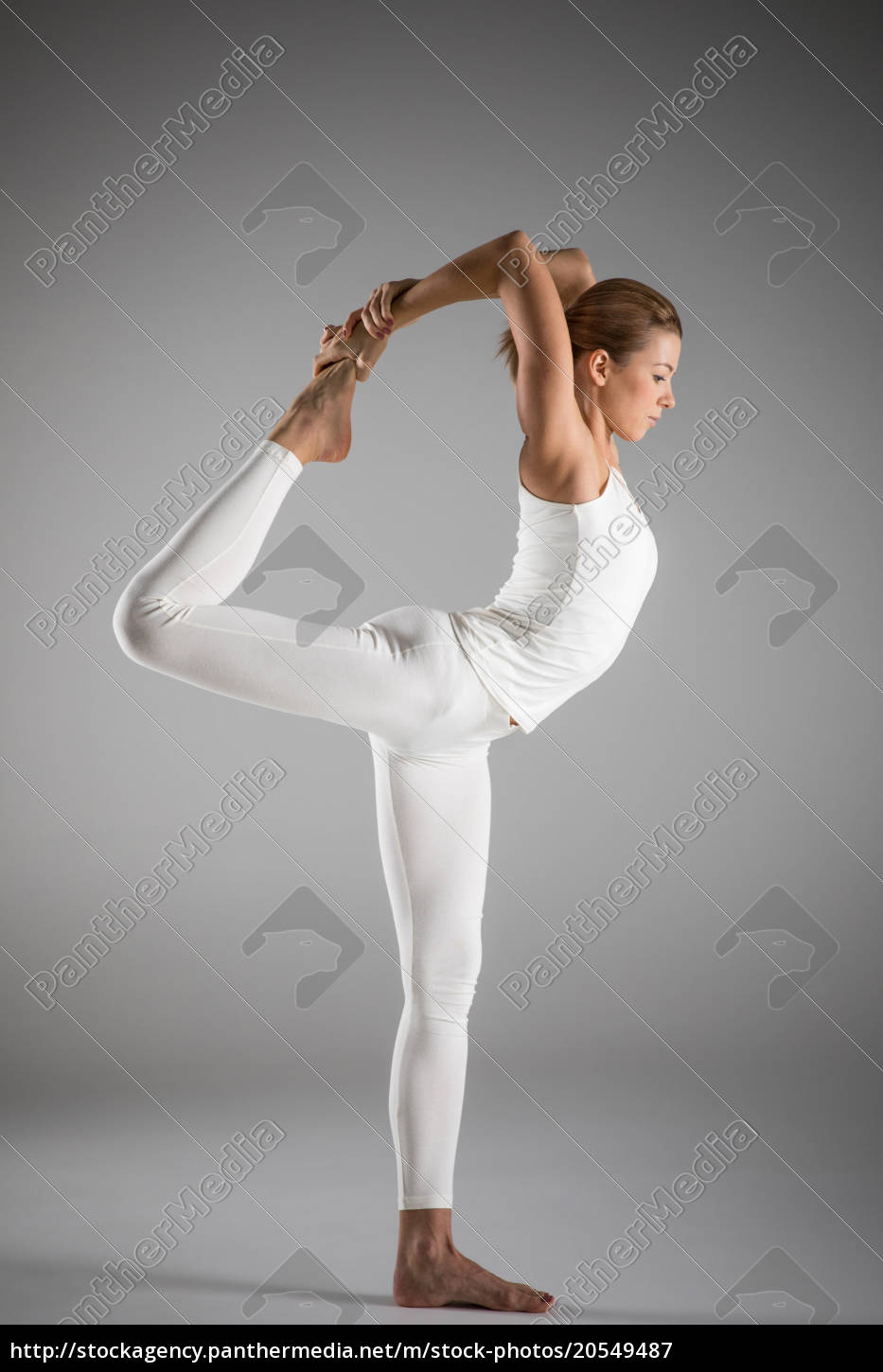 woman, standing, in, yoga, pose - 20549487