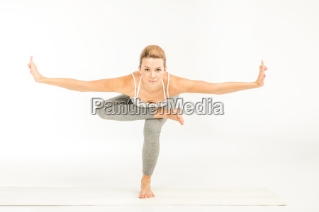 woman, standing, in, yoga, position - 20549277