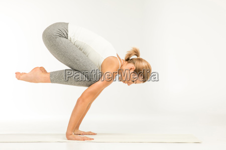 woman, standing, in, yoga, position - 20549295