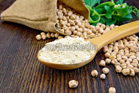 flour chickpeas in spoon on board