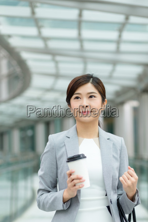 asian, business, woman, holding, coffee, cup - 20551211