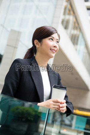 business, woman, hold, with, coffee, cup - 20551305