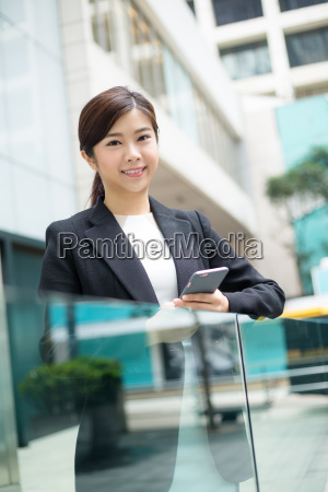 businesswoman, holding, a, phone - 20551287