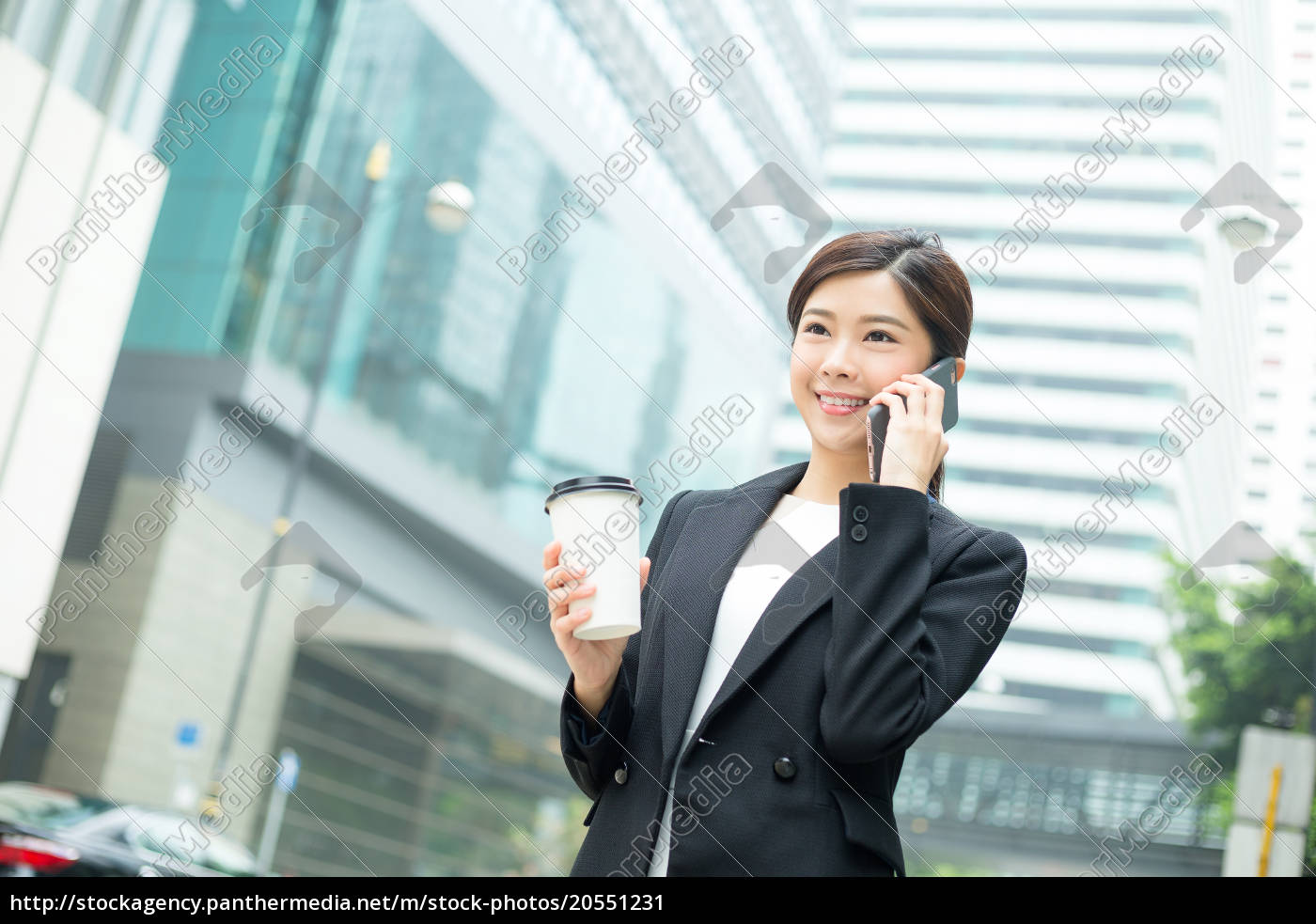 businesswoman, talking, to, cellphone, and, holding - 20551231