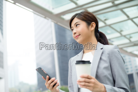 businesswoman, use, of, mobile, phone - 20551217