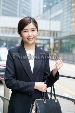 young, businesswoman, standing, at, outdoor - 20551289