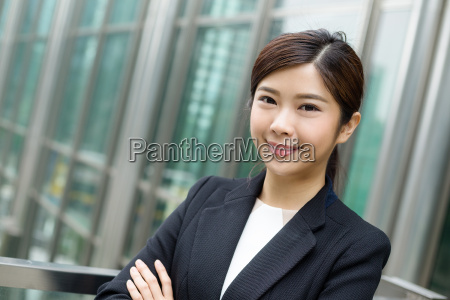 young, businesswoman, stanidng, outside - 20551267